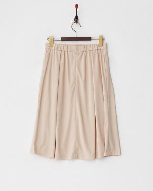 ベージュ タックミディスカートを見る
