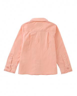 ピンク ruffle shirtを見る