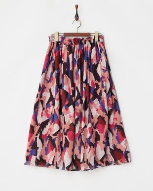 レッド リバーシブル幾何学柄スカートを見る