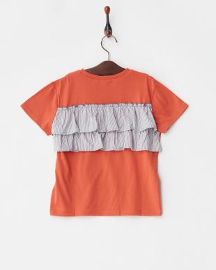 オレンジ バックコンシャスプリントTシャツを見る