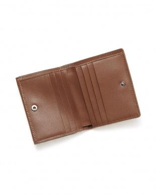 ミンクミンク  クロコダイルコンパクト財布見る