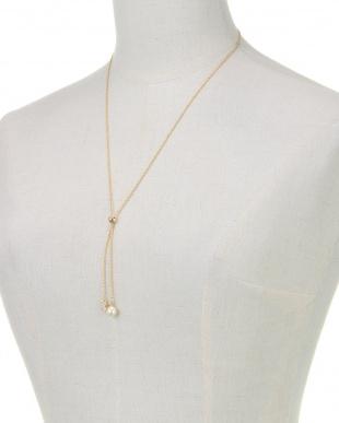 クリーム/ゴールド/クリスタル ジルコニアクローバー×クリーム貝パール スライダーネックレスを見る