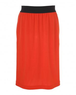 オレンジ トリアセドライポンチスカート アドーアを見る