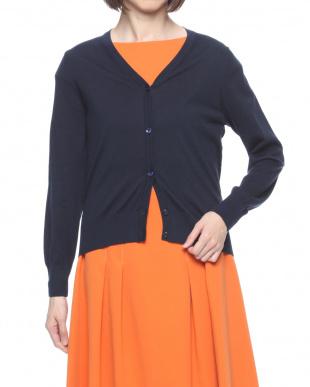 オレンジ セーターを見る