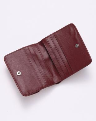 ローズレッド クロコダイル&牛革クロコ型押しコンパクト財布を見る