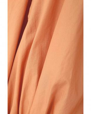オレンジ コンパクトコットンウエストリボンギャザーブラウス ヒューマン ウーマンを見る