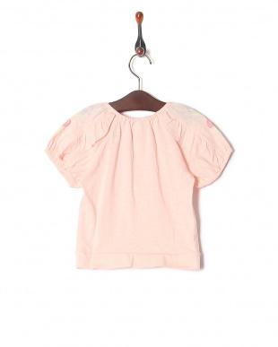 ピンク フラワープリントTシャツを見る