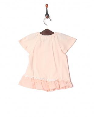 ピンク 袖フリルTシャツを見る