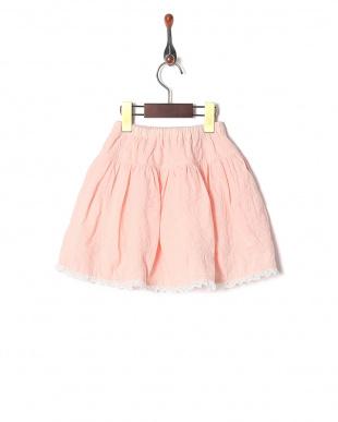 ピンク オーバーレーススカートを見る