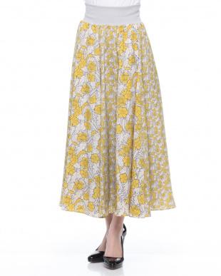 イエロー 花柄組み合わせロングスカートを見る