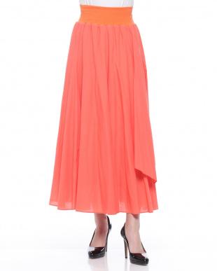 オレンジ フリル付ロングスカートを見る