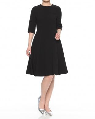 ブラック  MEEKAT/ミーキャット 後ろボタンデザイン ブラックドレスを見る