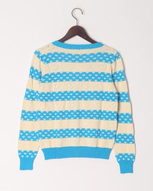 ブルー 【大人サイズ】ハート柄Vネックセーターを見る