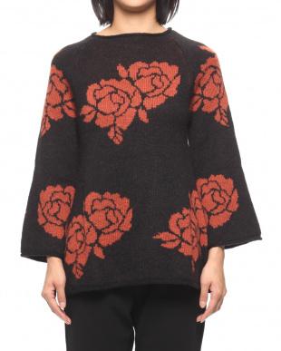ブラック*オレンジ フラワージャカードセーターを見る