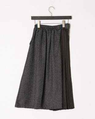チャコール プリーツアシメドッキングスカートを見る