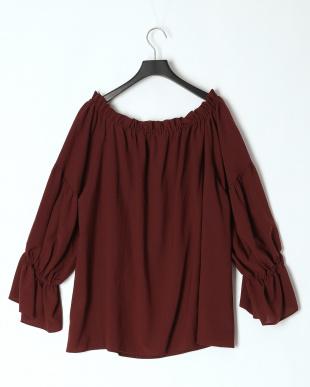 050  Gathered smock blouseを見る