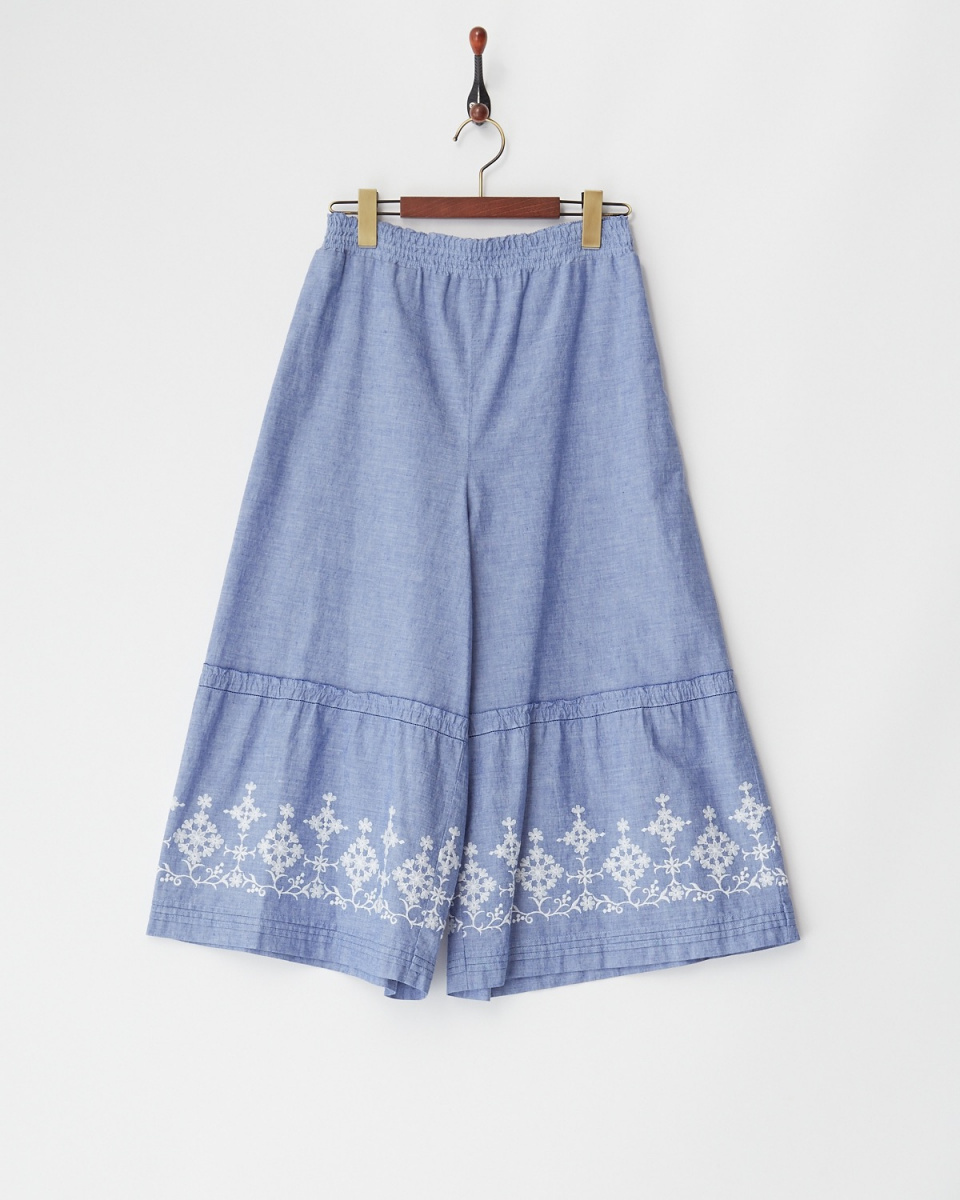 Pitchoune / blue motif embroidery flare switching pants